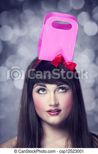 Beautifu brunette woman with present box. - csp12523001