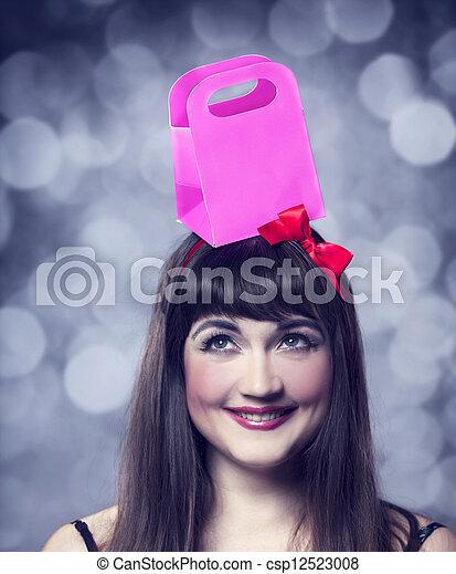 Beautifu brunette woman with present box. - csp12523008