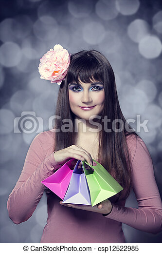 Beautifu brunette woman with present boxes - csp12522985