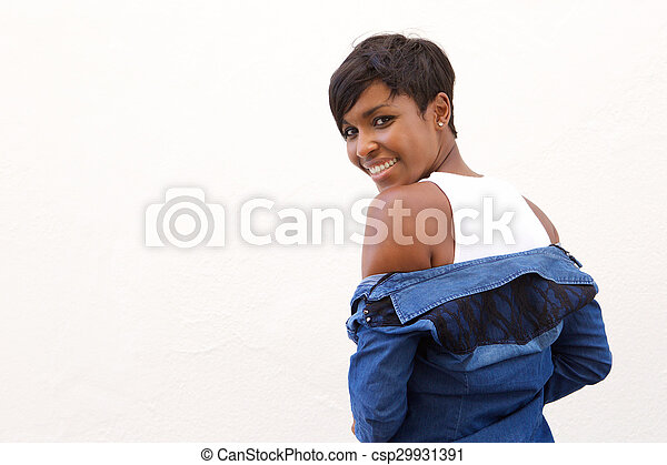 Beautiful african american woman looking over shoulder - csp29931391