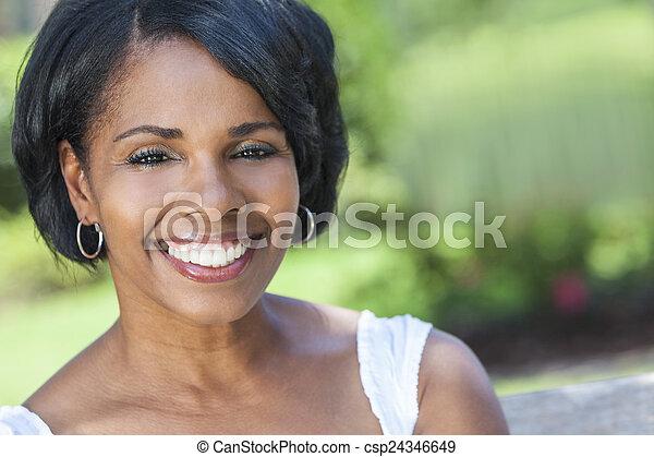 Beautiful African American Woman Outdoor Portrait - csp24346649