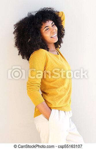 beautiful african american woman smiling - csp55163107