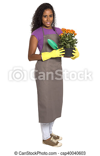 Beautiful African girl gardener with flower isolated on white background - csp40040603