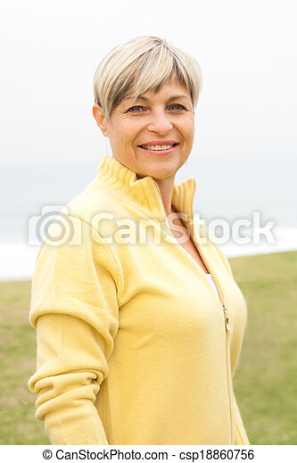 Beautiful aged woman in the park - csp18860756