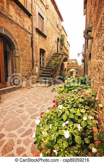 Beautiful alley in Civita di Bagnoregio, Lazio, Italy - csp89359216