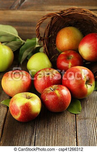Beautiful apples on brown wooden background - csp41266312