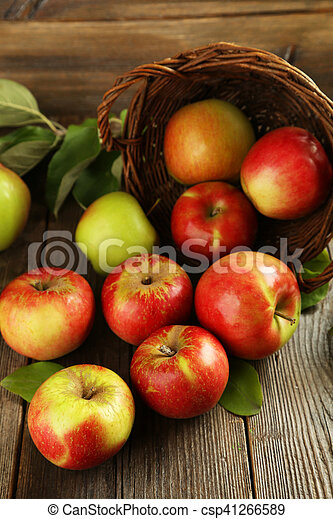 Beautiful apples on brown wooden background - csp41266589
