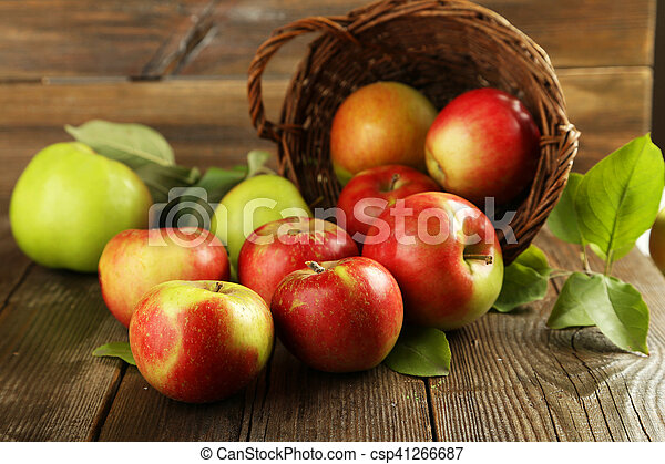 Beautiful apples on brown wooden background - csp41266687