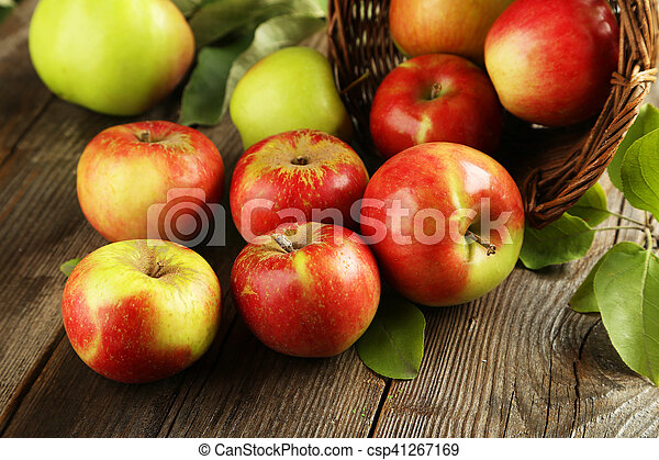 Beautiful apples on brown wooden background - csp41267169