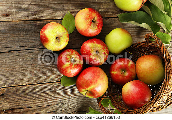 Beautiful apples on brown wooden background - csp41266153