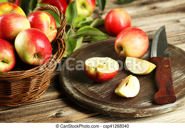 Beautiful apples on brown wooden background - csp41268040
