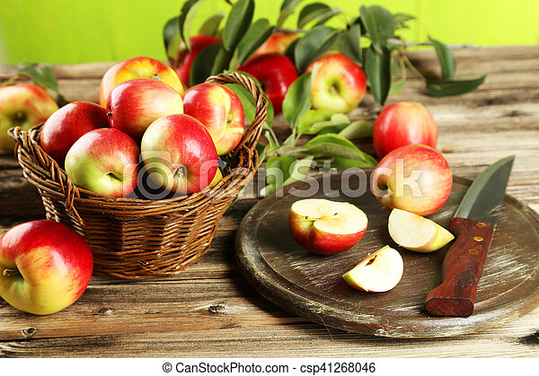 Beautiful apples on brown wooden background - csp41268046