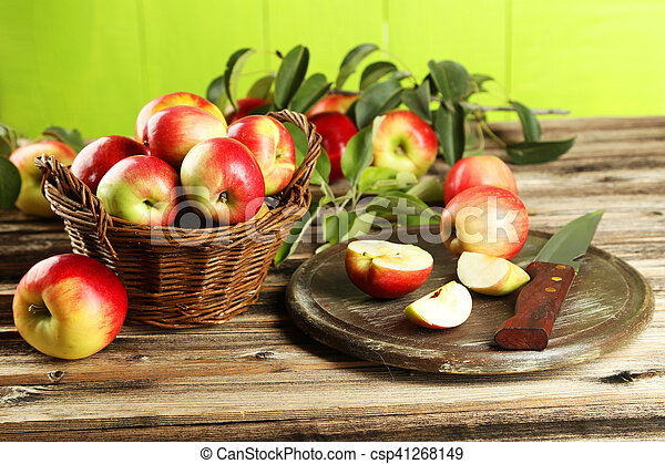 Beautiful apples on brown wooden background - csp41268149