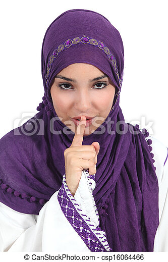 Beautiful arab woman asking for silence with the finger on lips - csp16064466