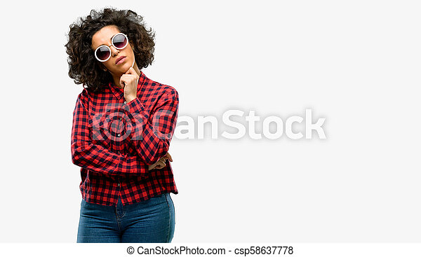 Beautiful arab woman thinking thoughtful with smart face - csp58637778