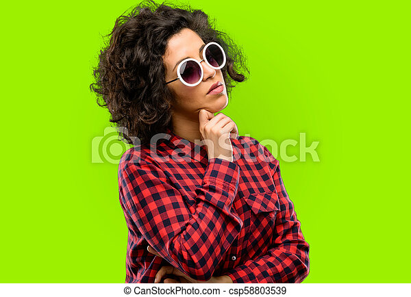 Beautiful arab woman thinking thoughtful with smart face - csp58803539
