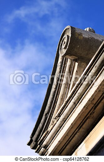 Beautiful architectural detail on stone cornice - csp64128762