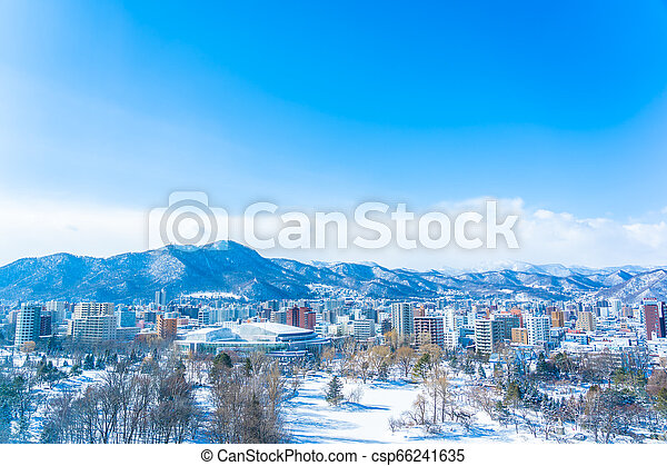 Beautiful architecture building with mountain landscape in winter season Sapporo city Hokkaido Japan - csp66241635