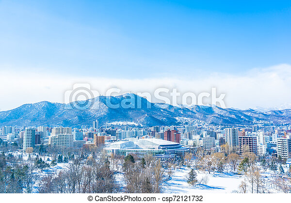 Beautiful architecture building with mountain landscape in winter season Sapporo city Hokkaido Japan - csp72121732