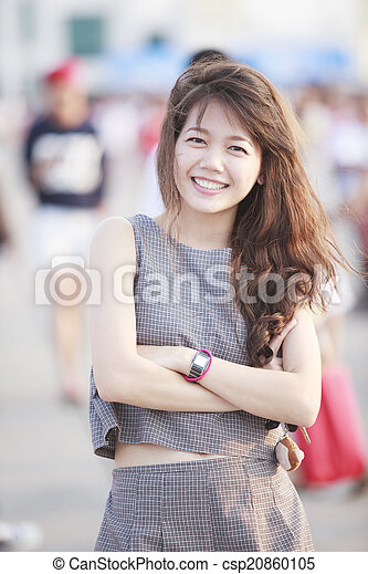 beautiful asian teen age standing with relaxing and smiling to c - csp20860105
