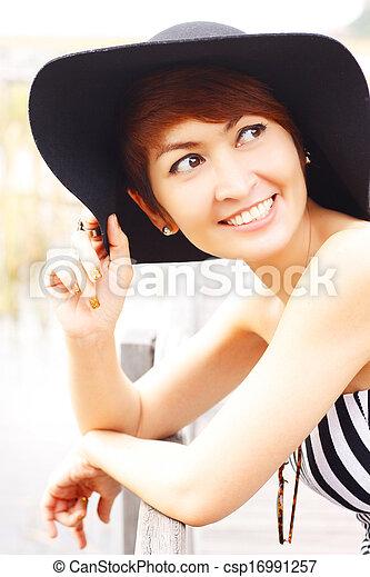 Beautiful Asian woman smiling - csp16991257