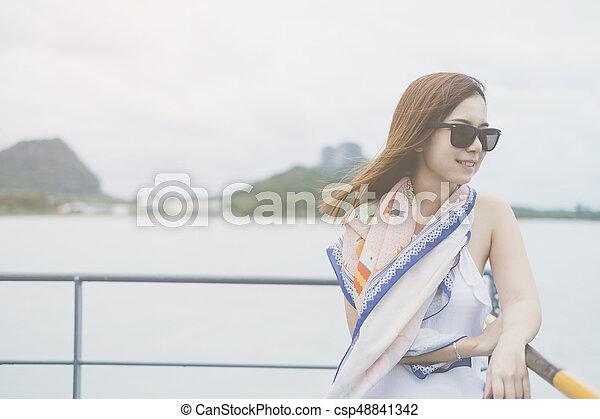 Beautiful Asian woman smiling - csp48841342