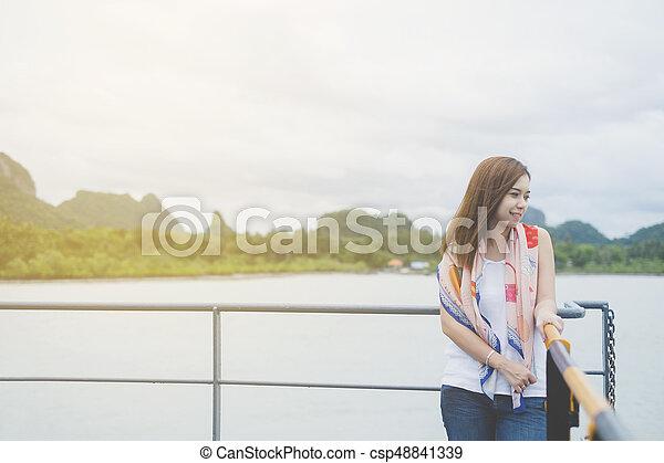 Beautiful Asian woman smiling - csp48841339