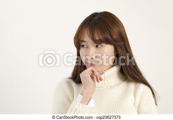 Beautiful asian woman thinking - csp23627373