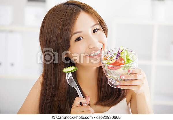 beautiful asian young woman eating healthy food - csp22930668