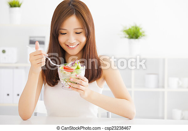 beautiful asian young woman eating healthy food - csp23238467