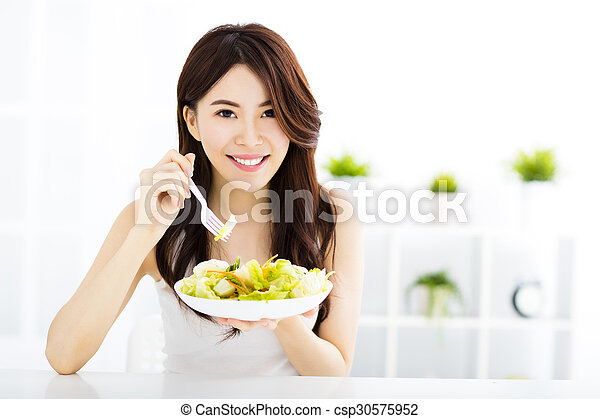 beautiful asian young woman eating healthy food - csp30575952