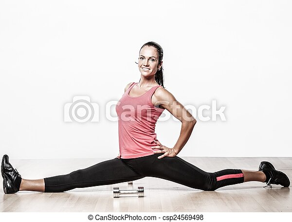 beautiful athlete woman doing split