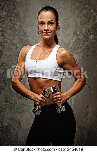 Beautiful athlete woman  with dumbbells. - csp12454619