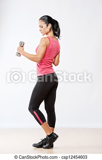 Beautiful athlete woman with dumbbells. - csp12454603