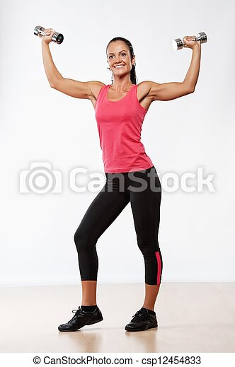 Beautiful athlete woman with dumbbells. - csp12454833