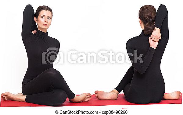 beautiful athletic girl in black suit doing yoga