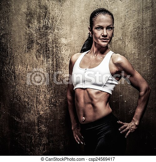 Beautiful athletic woman  with dumbbells - csp24569417