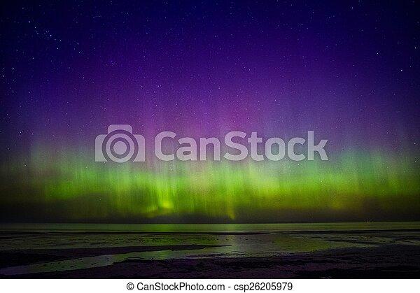 Beautiful Aurora Borealis over sea  - csp26205979