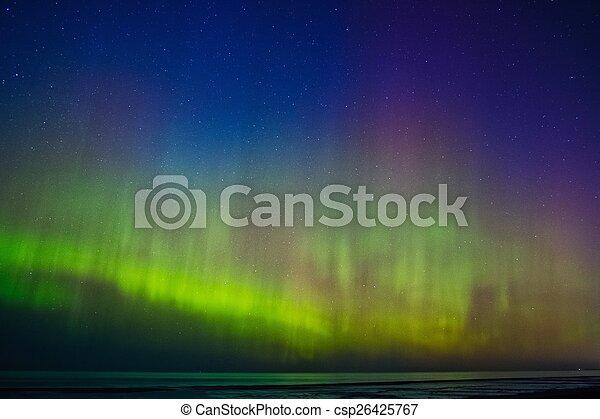 Beautiful Aurora Borealis over sea  - csp26425767