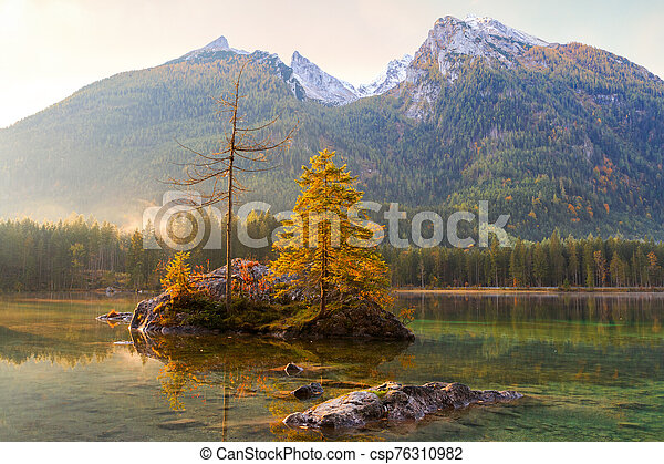 Beautiful autumn colors in the sunrise at the Hintersee lake in Bavaria alps - csp76310982
