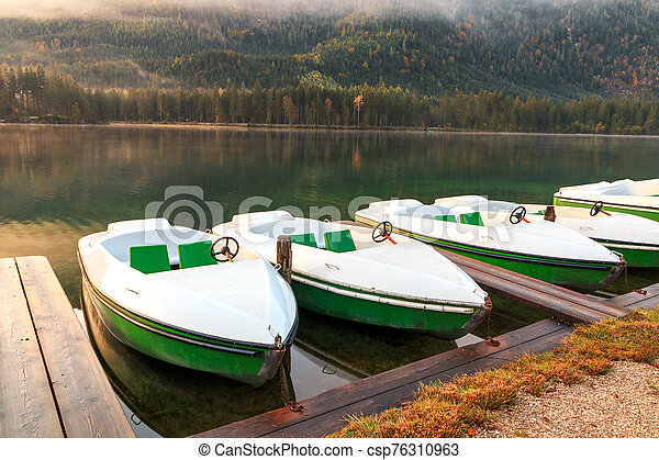 Beautiful autumn colors in the sunrise at the Hintersee lake in Bavaria alps - csp76310963