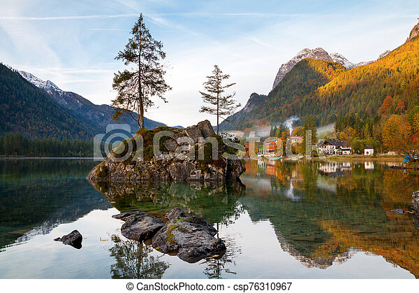 Beautiful autumn colors in the sunrise at the Hintersee lake in Bavaria alps - csp76310967