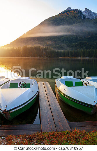 Beautiful autumn colors in the sunrise at the Hintersee lake in Bavaria alps - csp76310957