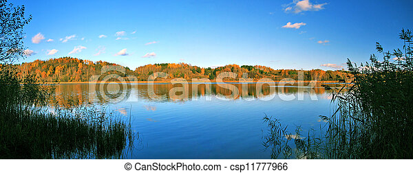 beautiful autumn panoramic landscape of lake and forest - csp11777966