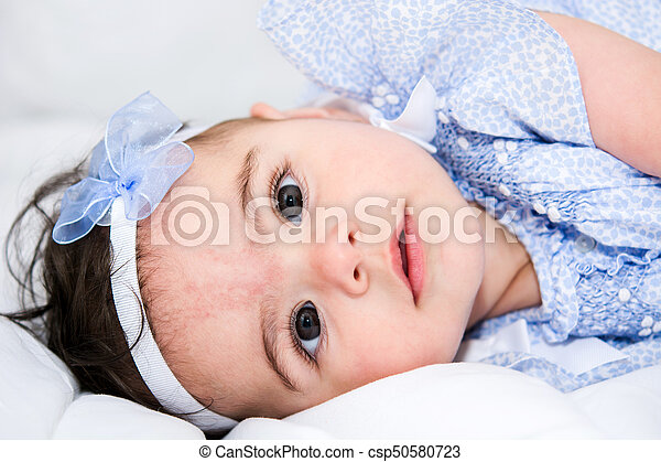 Beautiful baby girl on a bed - csp50580723