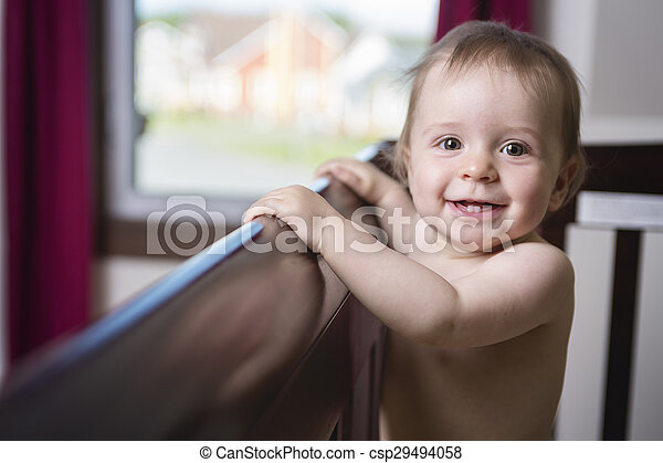 beautiful baby in a crib at home - csp29494058