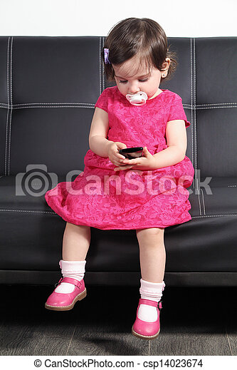 Strange Beautiful Baby Playing With A Smart Phone At Home Machost Co Dining Chair Design Ideas Machostcouk