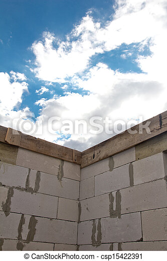 beautiful background of a brick wall and sky with clouds - csp15422391