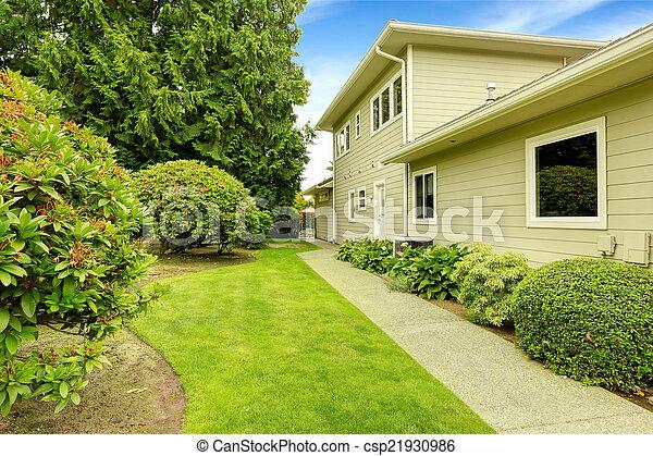 Beautiful backyard garden with walkway. Real estate in Federal W - csp21930986