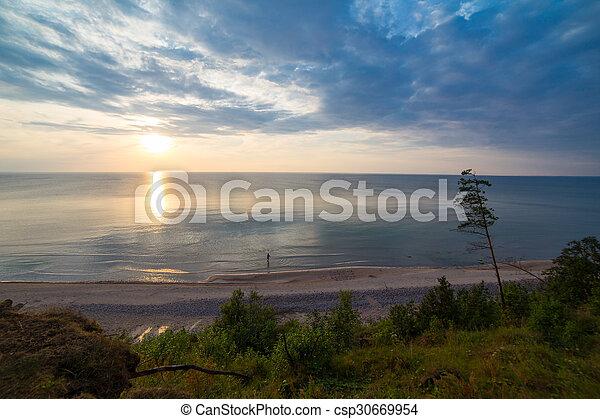 Beautiful Baltic sea coast landscape at sunset - csp30669954